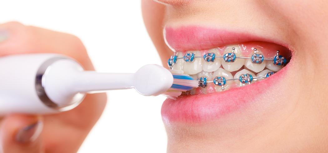 Person brushing teeth image